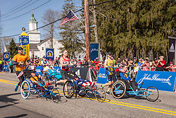 Boston Marathon start, inspired by Team Hoyt a group of handicapped wheelchair teams take off from Hopkinton on their way to Boylston Street 26 miles away