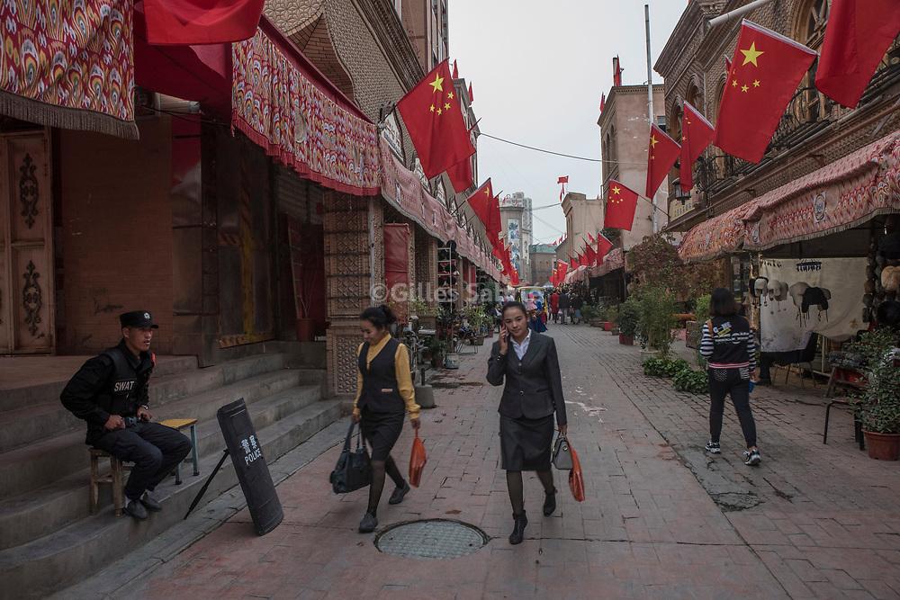 Kashgar. October 1st, 2017<br /> A police guard on a commercial street of Kashgar.