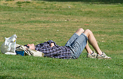 ©Licensed to London News Pictures 15/04/2020  <br /> Greenwich, UK. A man sunbathing in Greenwich park, Greenwich, London as people get out of the house from coronavirus lockdown to exercise for an hour. Photo credit:Grant Falvey/LNP