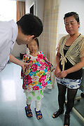 GUANGZHOU, CHINA - JUNE 18: (CHINA OUT) <br /> <br /> Young Girl With Ovarian Malignant Teratoma<br /> <br /> Han Bingbing, a 15-year-old girl with ovarian malignant teratoma, walks in sickroom at Fuda Cancer Hospital guangzhou on June 18, 2014 in Guangzhou, Guangdong province of China. Han Bingbing, a 15-year-old girl in Heilongjiang, has been diagnosed with ovarian malignant teratoma in 2009, which makes her belly grows bigger and bigger. Han Bingbing was accepted by Fuda Cancer Hospital guangzhou after so many times being rejected by other hospitals. The fee of curing Han Bingbing\'s disease is around 2000,000 Yuan (about 320,200 USD). <br /> ©Exclusivepix