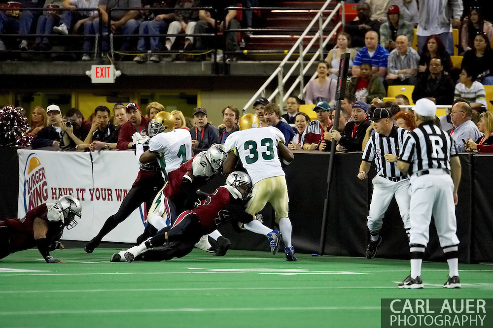 4/12/2007 - The Alaska Wild defense led by Losepa Nicholas-Silvera (45) stop Frisco's Terrance Smith (33) in the first professional football game in Alaska.