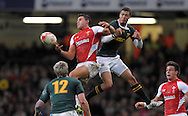 Photo © TOM DWYER / SECONDS LEFT IMAGES 2010 - Rugby Union - Invesco Perpetual Series - Wales v South Africa - 13/11/10 - Wales' Lee Byrne battles for a high ball with South Africa's Bjorn Basson - at Millennium Stadium Cardiff Wales UK -  All rights reserved