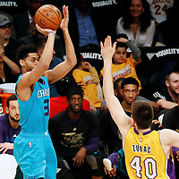 28 February 2017: Charlotte Hornets guard Jeremy Lamb (3) takes a jump shot over Los Angeles Lakers center Ivica Zubac (40) during the Charlotte Hornets 109-104 victory over the LA Lakers, at the Staples Center, Los Angeles, California, USA.