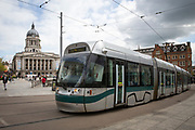 A Nottingham Express Transit (NET) tram, number 210, travelling through Nottingham city centre outside Old Market Square, Nottingham, Nottinghamshire, United Kingdom. Trams run throughout the city to stop people using cars and encourage them to use more sustainable transport mechanisms.  (photo by Andrew Aitchison / In pictures via Getty Images)