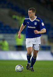 CARDIFF, WALES - Tuesday, February 14, 2012: Cardiff City's Ben Turner in action against Peterborough United during the Football League Championship match at the Cardiff City Stadium. (Pic by David Rawcliffe/Propaganda)