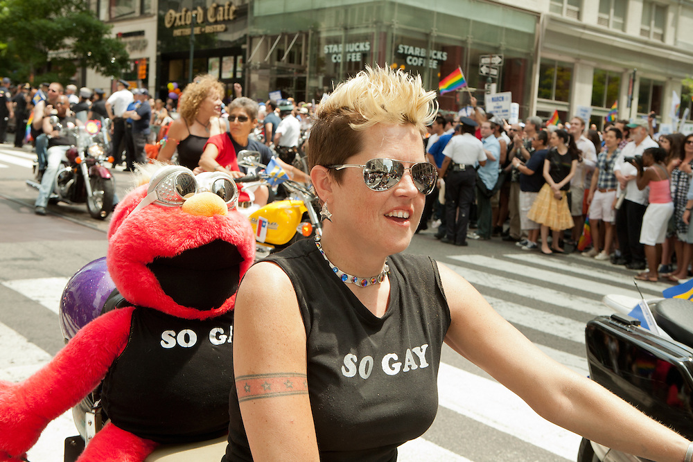 The Sirens Motorcycle Club riding in the 2011 Pride Parade on New York's Fifth Avenue. the 2011 Pride Parade on New York's Fifth Avenue.