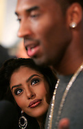 Vanessa Bryant listens to her husband Kobe give interviews during the launch of his Zoom Kobe 1 shoe at the Nike Town in Beverly Hills Friday February 10, 2006.