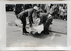 "Injured Woman being placed on a gurney. On-The-Scene Accident Photograph, Elm & Orchard Streets New Haven CT circa December 1956. This photo is part of a set of 15 images captured of this accident by photographer Robert F. Anderson, Legal Photo Service. A scan of a 3.5""x5"" original lab print, negative or precise records not found. Not yet restored from deterioration, date is approximate."