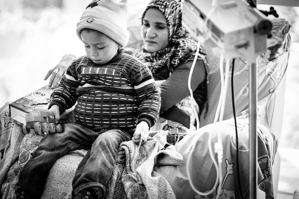 Zeyad, 3.5, playing with his new toy during his chemotherapy session.
