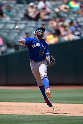 OAKLAND, CA - JULY 23:  Jose Reyes #7 of the Toronto Blue Jays throws to first base against the Oakland Athletics during the sixth inning at O.co Coliseum on July 23, 2015 in Oakland, California. The Toronto Blue Jays defeated the Oakland Athletics 5-2. (Photo by Jason O. Watson/Getty Images) *** Local Caption *** Jose Reyes