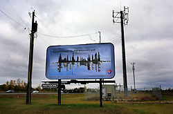 CANADA EDMONTON 7OCT09 - Billboard advertisement by French oil company TOTAL in Edmonton, Alberta, Canada...The tar sand deposits lie under 141,000 square kilometres of sparsely populated boreal forest and muskeg and contain about 1.7 trillion barrels of bitumen in-place, comparable in magnitude to the world's total proven reserves of conventional petroleum. Current projections state that production will  grow from 1.2 million barrels per day (190,000 m³/d) in 2008 to 3.3 million barrels per day (520,000 m³/d) in 2020 which would place Canada among the four or five largest oil-producing countries in the world...The industry has brought wealth and an economic boom to the region but also created an environmental disaster downstream from the Athabasca river, polluting the lakes where water and fish are contaminated. The native Indian tribes of the Mikisew, Cree, Dene and other smaller First Nations are seeing their natural habitat destroyed and are largely powerless to stop or slow down the rapid expansion of the oil sands development, Canada's number one economic driver...jre/Photo by Jiri Rezac / GREENPEACE..© Jiri Rezac 2009