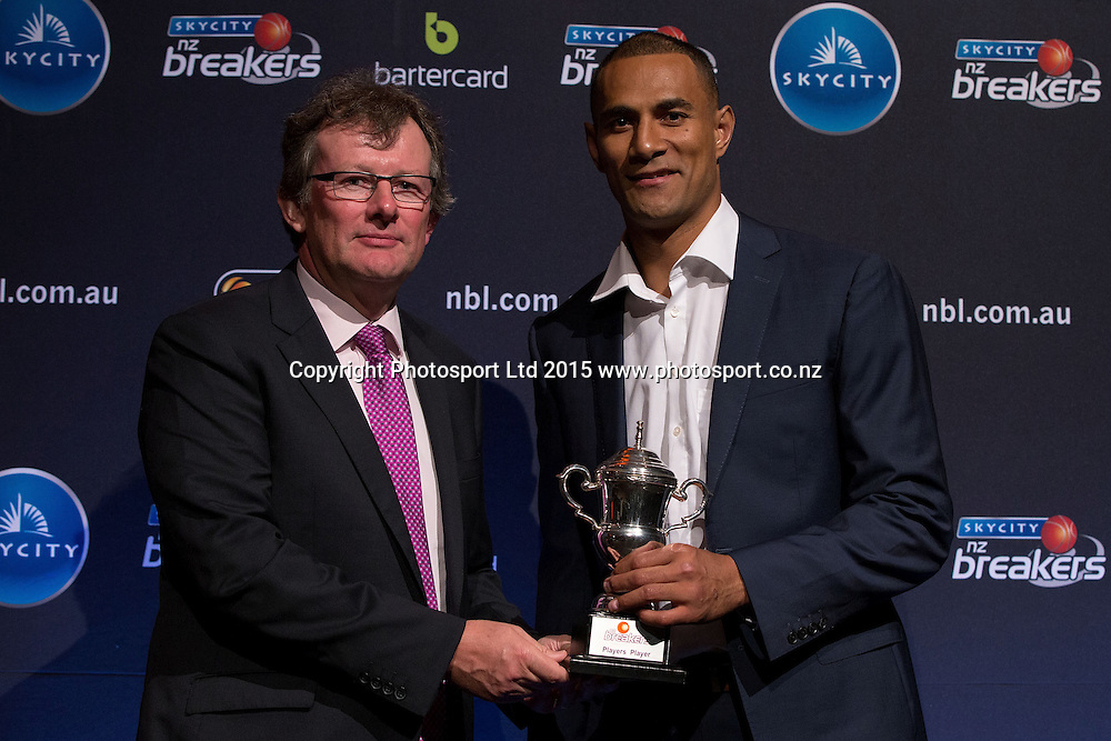 John Scott, CEO of Bartercard New Zealand, left,  presented the Player's Player Award to Mika Vukona at the SkyCity Breakers Awards, 2014-15, SkyCity Convention Centre, Auckland, New Zealand, Friday, March 20, 2015. Copyright photo: David Rowland / www.photosport.co.nz