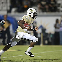 ORLANDO, FL - OCTOBER 09:  Justin Holman #13 of the UCF Knights scrambles with the football at Bright House Networks Stadium on October 9, 2014 in Orlando, Florida. (Photo by Alex Menendez/Getty Images) *** Local Caption *** Justin Holman