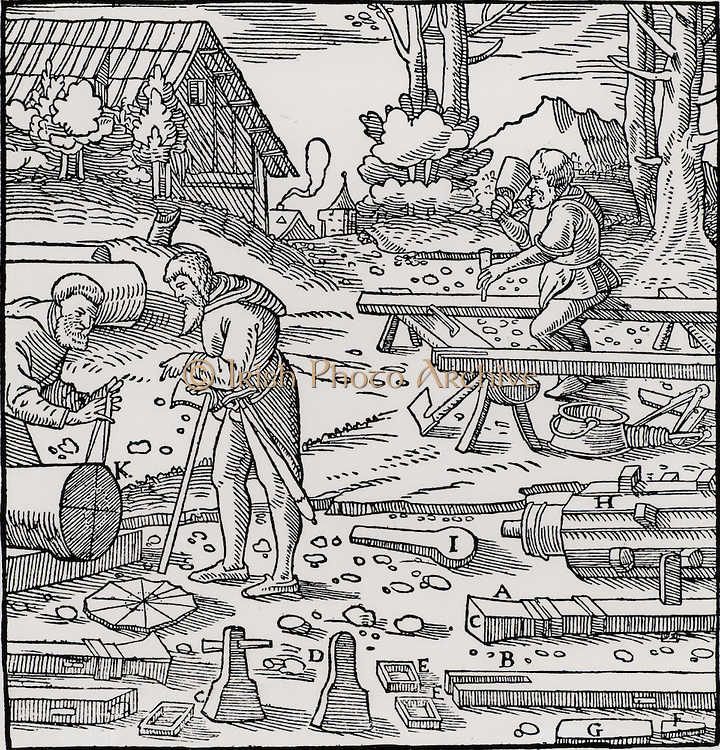 Carpenters constructing a stamping mill for breaking up ores and extraction of metals.  Men on the left are measuring up a baulk of timber, K, to form a cam-shaft.  A completed cam-shaft at H fitted with cams I. B is the stem of a single stamp, A.  All the pieces of the mechanism are made of wood.  From 'De re metallica', by Agricola, pseudonym of Georg Bauer (Basle, 1556).  Woodcut.