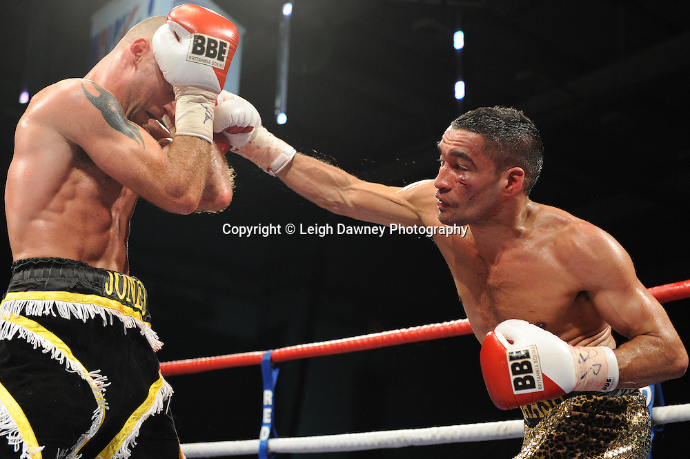 Ben Jones (black shorts) defeats Akaash Bhatia for the English Super Featherweight Title at Medway Park, Gillingham, Kent, UK on 13th May 2011. Frank Maloney Promotions. Photo credit © Leigh Dawney 2011.