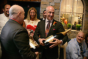 Photo by Matt Roth<br /> Assignment ID: 30148071A<br /> <br /> Two methusalems of Perrier-Jouet were presented as gifts to wedding couple David Hagedorn, left, and Michael Widomski, right, from Fiola's owner, Chef Fabio Trabocchi, and his wife Maria Trabocchi, background, Sunday, September 22, 2013.