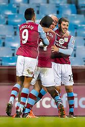 Ciaran Clark of Aston Villa celebrates with Micah Richards and Carles Gil after  scoring a goal to make it 1-0 - Mandatory byline: Rogan Thomson/JMP - 19/01/2016 - FOOTBALL - Villa Park Stadium - Birmingham, England - Aston Villa v Wycombe Wanderers - FA Cup Third Round Replay.
