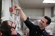 "Dessert chef Johnny Iuzzini feeds a freind a sample of rhubarb ""spaghetti."""
