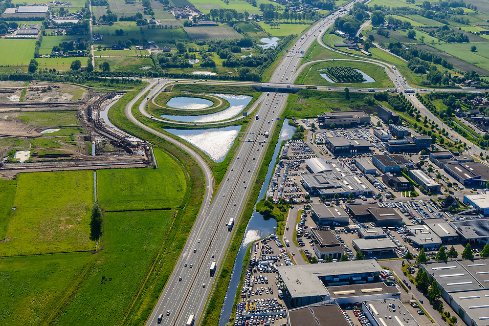 Nederland, Utrecht, Veenendaal, 29-05-2019; Rijksweg A12 met afslag naar bedrijventerrrein.<br /> Motorway A12.<br /> luchtfoto (toeslag op standard tarieven);<br /> aerial photo (additional fee required);<br /> copyright foto/photo Siebe Swart