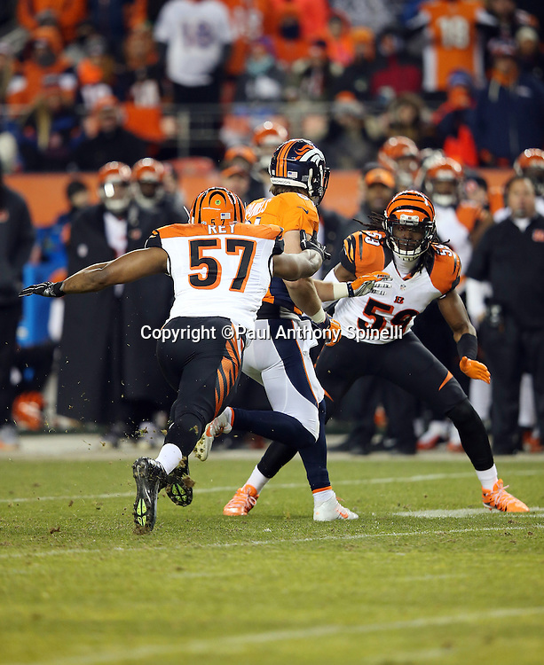 Cincinnati Bengals outside linebacker Vincent Rey (57) and Cincinnati Bengals outside linebacker Emmanuel Lamur (59) chase Denver Broncos tight end Owen Daniels (81) after a pass reception during the 2015 NFL week 16 regular season football game against the Denver Broncos on Monday, Dec. 28, 2015 in Denver. The Broncos won the game in overtime 20-17. (©Paul Anthony Spinelli)