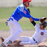 Shiprock Chieftain Cameron Phillips (1) slides past Hot Springs Tiger Nick Moreno (9) into second base Saturday at Thoreau High School.