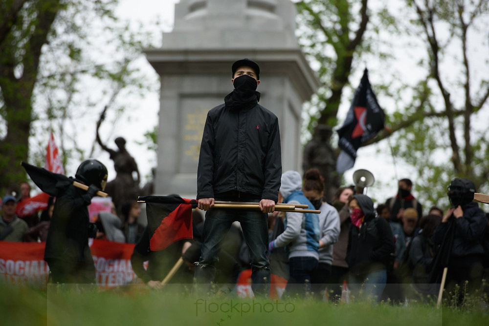 Counter-protesters, including members of North Shore Antifa (short for anti-facist), gather at Boston Common during a protest by factions of the alt-right, May 13, 2017.<br /> Photo / Kate Flock