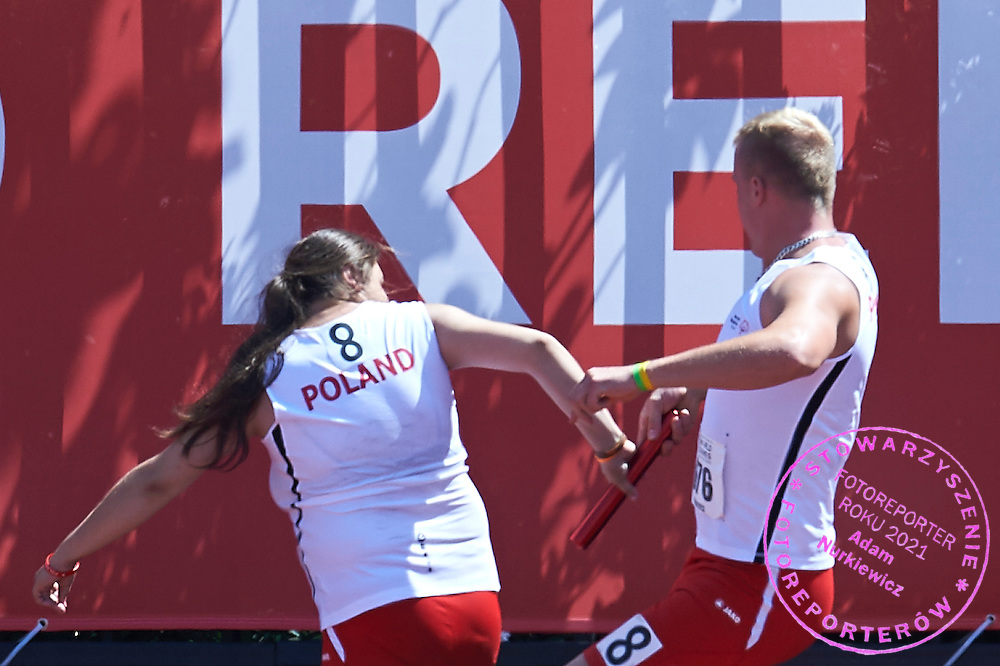 SO Poland athletes (R) Radoslaw Juszkiewicz and (L) Aneta Patoka compete at athletics relay 4 x 100 meters during eighth day of the Special Olympics World Games Los Angeles 2015 on August 1, 2015 at Loker Stadium on USC (University of Southern California) in Los Angeles, USA.<br /> USA, Los Angeles, August 1, 2015<br /> <br /> Picture also available in RAW (NEF) or TIFF format on special request.<br /> <br /> For editorial use only. Any commercial or promotional use requires permission.<br /> <br /> Adam Nurkiewicz declares that he has no rights to the image of people at the photographs of his authorship.<br /> <br /> Mandatory credit:<br /> Photo by &copy; Adam Nurkiewicz / Mediasport