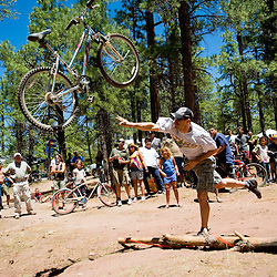 """Gavin Flury, winner of the Huffy toss contest, shows his skill on his winning throw on Sunday.""""It's all in the technique, you've got to get it to roll,"""" Flury said. ."""