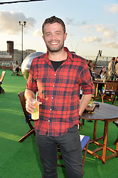 SVEN-HANSON BRITT at the launch of the Orangina Boulers Rooftop Petanque held on the top floor of the Stratford Multistorey Car Park, Great Eastern Way, London E15 on 26th August 2015.