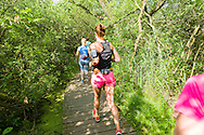 Nederland, Vught, 20150617.<br /> Hardlopen, ochtend loop in de Moerputten.<br /> Zonnige lente ochtend. Hardlopers met veelkleurige loopkleding.<br /> De Moerputten is een natuurgebied in de Nederlandse provincie Noord-Brabant, gelegen nabij 's-Hertogenbosch. Het 118 hectare grote terrein behoort tot de Natura 2000-gebieden en is in beheer bij Staatsbosbeheer.<br /> Loopschool Wim Akkermans<br /> <br /> Netherlands, Vught, 20150617}<br /> Running, morning walk in the Moerputten.<br /> Sunny spring morning. Runners with multicolored clothes walking.<br /> The Moerputten is a nature reserve in the Dutch province of North Brabant, near 's-Hertogenbosch. The 118-hectare site is part of the Natura 2000 areas and is managed by the Forestry Commission.<br /> Running School Wim Akkermans