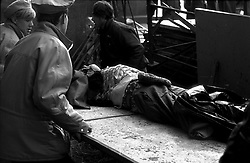 Russian peoples carry a wounded man after clash with Russian special forces on the barricades in downtown of Moscow during a constitutional crisis in Moscow, Russia, 02 October 1993. The constitutional crisis of 1993 was a political stand-off between the Russian president and the Russian parliament that was resolved by using military force. The relations between the president and the parliament had been deteriorating for a while. The constitutional crisis reached a tipping point on 21 September 1993, when President Boris Yeltsin purported to dissolve the country's legislature (the Congress of People's Deputies and its Supreme Soviet), although the president did not have the power to dissolve the parliament according to the then-current constitution. Yeltsin used the results of the referendum of April 1993 to justify his actions. In response, the parliament declared that the president's decision was null and void, impeached Yeltsin and proclaimed vice president Aleksandr Rutskoy to be acting president.The situation deteriorated at the beginning of October. On 3 October, demonstrators removed police cordons around the parliament and, urged by their leaders, took over the Mayor's offices and tried to storm the Ostankino television centre. The army, which had initially declared its neutrality, by Yeltsin's orders stormed the Supreme Soviet building in the early morning hours of 4 October, and arrested the leaders of the resistance. The ten-day conflict had seen the deadliest street fighting in Moscow since October 1917.[2] According to government estimates, 187 people were killed and 437 wounded, while sources close to Russian communists put the death toll at as high as 2,000.