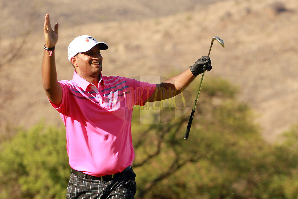 Jay Pillay celebrates a good approach shot on the 18th hole during the second round of the Sanlam Cancer Challenge Finals held at the Gary Player Golf Club in Sun City near Johannesburg on the 22nd October 2013. Photo by Jacques Rossouw - SPORTZPICS