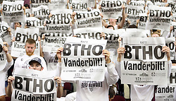 Texas A&M's student section holds up newspapers as the starting lineup for Vanderbilt is announced before the start of an NCAA college basketball game, Saturday, March 5, 2016, in College Station, Texas. Texas A&M won 76-67. (AP Photo/Sam Craft)