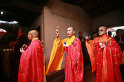 QUANZHOU, CHINA - JANUARY 10: (CHINA OUT) <br /> <br /> Monks chant for monk Fuhou\'s body which was found not rotted after putting in a vat for three and a half years at Puzhao temple on Zimao Mountain on January 10, 2016 in Quanzhou, Fujian Province of China. 94-year-old monk Fuhou died in 2012 and his body was put by the sitting position into a vat with a cover for three and a half years. Monks found that Fuhou\'s body wasn\'t rotted on an opening vat rite on January 10 at Puzhao temple on Zimao Mountain in Quanzhou. The body would be cleaned and stuck with gold to be made into a golden Buddha.  <br /> ©Exclusivepix Media