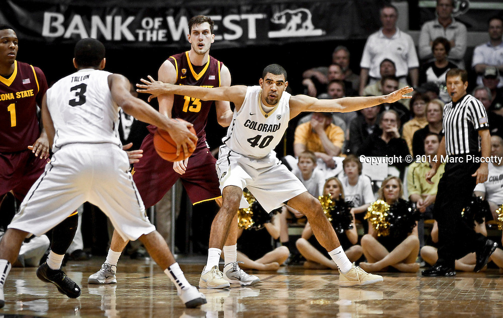 SHOT 2/20/14 12:03:53 AM - Colorado's Josh Scott #40 tries to post up in front of Arizona State's Jordan Bachynski #13 during their regular season Pac-12 basketball game at the Coors Events Center in Boulder, Co. Colorado won the game 61-52.<br /> (Photo by Marc Piscotty / &copy; 2014)