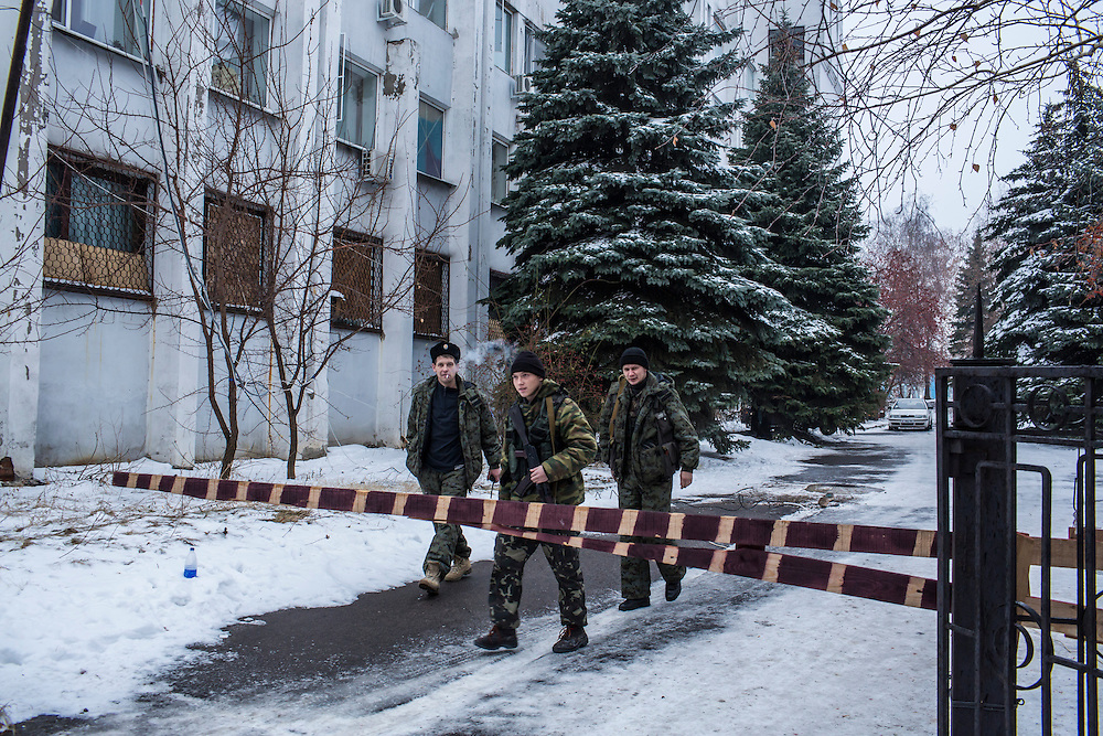 PERVOMAISK, UKRAINE - DECEMBER 8, 2014: Petr Khokhlov, center, a member of the First Cossack Regiment Named Platov of the Great Don Army, outside the dormitory where he is stationed in Pervomaisk, Ukraine. CREDIT: Brendan Hoffman for The New York Times