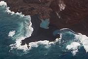 Kilauea's east rift zone overflight: The pond created by the flow is blue...Such an amazing sight to see after all of the destruction the flow caused.