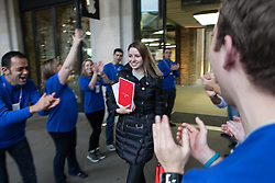 The new iPad Air on sale in London. <br /> Anya Bagui, originally from Russia but living in the UK holds onto her new iPad Air while being cheered by Apple employees at Covent Garden's Apple store, London, United Kingdom. Friday, 1st November 2013. Picture by Daniel Leal-Olivas / i-Images