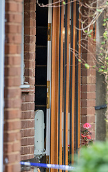 © Licensed to London News Pictures. 20/12/2019. Woking, UK. The front door to a house in Woking where a woman was murdered yesterday remains slightly ajar showing the seat of a stair lift. It is being reported that two men have been arrested.  Photo credit: Peter Macdiarmid/LNP