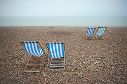 25/09/2013 . Brighton, UK. Empty deck chairs on an empty beach on a foggy and overcast day at Brighton seafront where the Labour Party COnference is in it's last day. Photo credit : Ben Cawthra