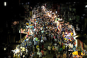 The busy road surrounding the train station of Bandra (East), Mumbai, India, is photographed from a rooftop. In the nearby slum area, child actors Azharuddin Ismail and Rubina Ali, playing the roles of 'young Salim' and 'young Latika' in the movie Slumdog Millionaire, winner of 8 Oscar Academy Awards in December 2008, still live with their families. Various promises were made to lift the two young actors from poverty and slum-life but as of the end of May 2009 anything is yet to happen. Rubina's house was recently demolished with no notice as it lay on land owned by the Maharashtra train authorities and she is now permanently living with her uncle's family in a home a stone-throw away in the same slum. Azharuddin's home too was demolished in the past two weeks, as it happens every year in his case, because the concrete walls were preventing local authorities to clear a drain passing right behind it. As usual, his father is looking into restoring the walls as soon as the work on the drain has been completed.