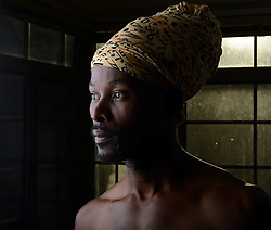 WASHINGTON, DC - August 14: Portraiture photography of Haitian artist Armand Myrthil, 38, from Greenbelt, MD, and his son Taphary Pierre, 12, at my studio apartment, Thursday, August, 14, 2014. (Photo by Astrid Riecken)