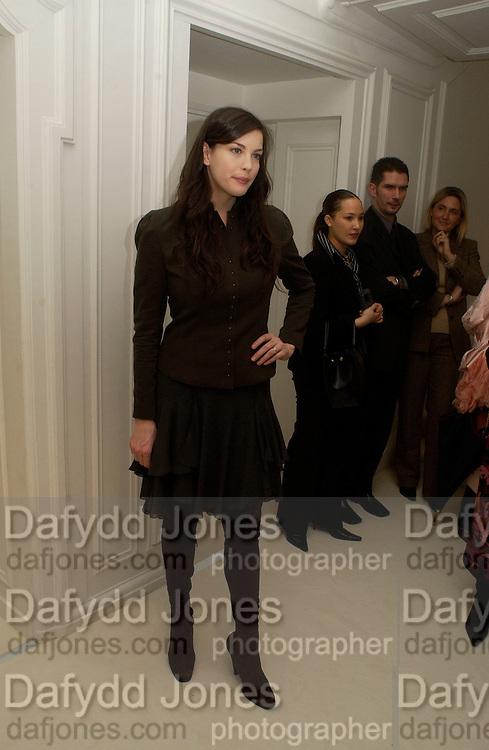 Liv Tyler, Givenchy couture show, Julian Macdonald's last ( ?)  Paris, 20 January 2004. © Copyright Photograph by Dafydd Jones 66 Stockwell Park Rd. London SW9 0DA Tel 020 7733 0108 www.dafjones.com
