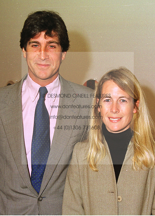 MR RUPERT & the HON.MRS SCOTT, she is the daughter of Lord Montagu of Beaulieu,  at an exhibition in London on 15th September 1998.MKB 54