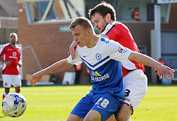 Peterborough United's Harry Anderson battles with Walsall's Andy Taylor - Photo mandatory by-line: Joe Dent/JMP - Mobile: 07966 386802 - 06/04/2015 - SPORT - Football - Peterborough - ABAX Stadium - Peterborough United v Walsall - Sky Bet League One