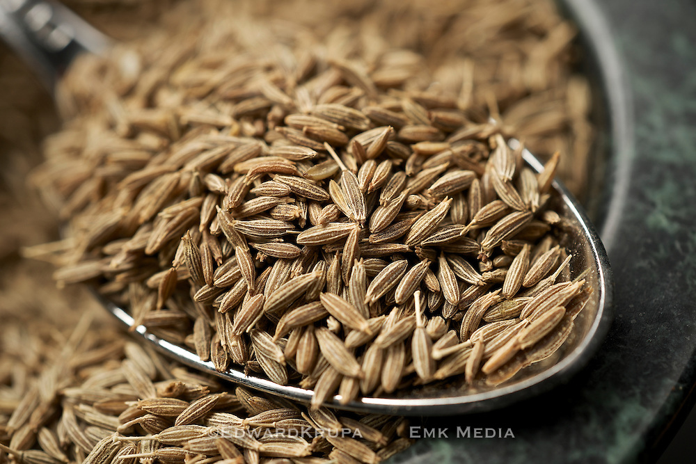 Close up of fennel seeds in a spoon.