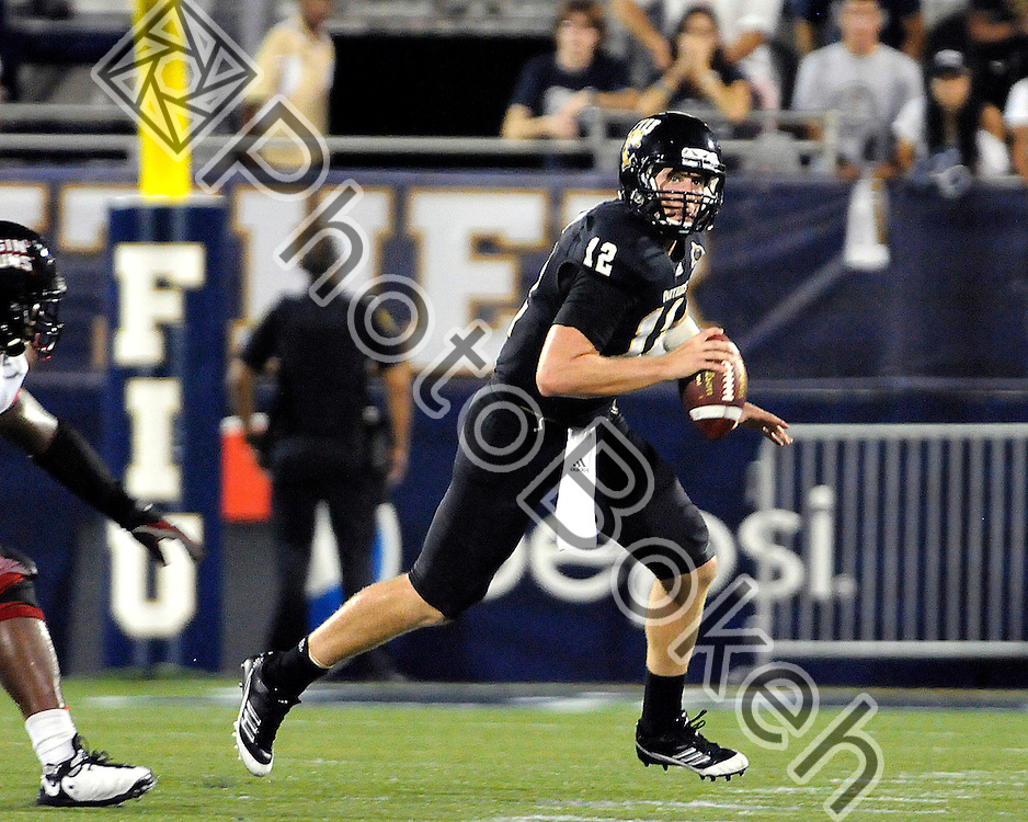 2011 September 24 - Florida International's quarterback Jake Medlock (12) looking to pass the ball. Florida International University Golden Panthers fell to Louisiana-Lafayette Rajun Cajuns 36-31 at Alfonso Field at the FIU Football Stadium, Miami, Florida. (Photo by: www.photobokeh.com / Alex J. Hernandez)