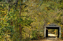 2015 Oct 19:   Parke County Indiana is the site of the Indiana Covered Bridge Festival every October.  This is the Rush Creek Bridge.  It was built over Rush Creek on County Road 900n in 1904 by Wm. Hendricks. The bridge has a 77' span.<br /> <br /> This image was produced in part utilizing High Dynamic Range (HDR) processes.  It should not be used editorially without being listed as an illustration or with a disclaimer.  It may or may not be an accurate representation of the scene as originally photographed and the finished image is the creation of the photographer.