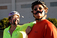 Laura Rea (left) and Kevin Rankin, both of Beavercreek are two of the cyclists taking part in the Dayton Movember Mustache Ride to benefit men's cancer awareness and research through downtown Dayton on First Friday, November 4, 2011.