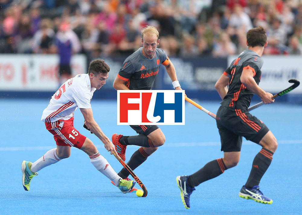 LONDON, ENGLAND - JUNE 24: Phil Roper of England breaks away from Billy Bakker of the Netherlands during the semi-final match between England and the Netherlands on day eight of the Hero Hockey World League Semi-Final at Lee Valley Hockey and Tennis Centre on June 24, 2017 in London, England. (Photo by Steve Bardens/Getty Images)